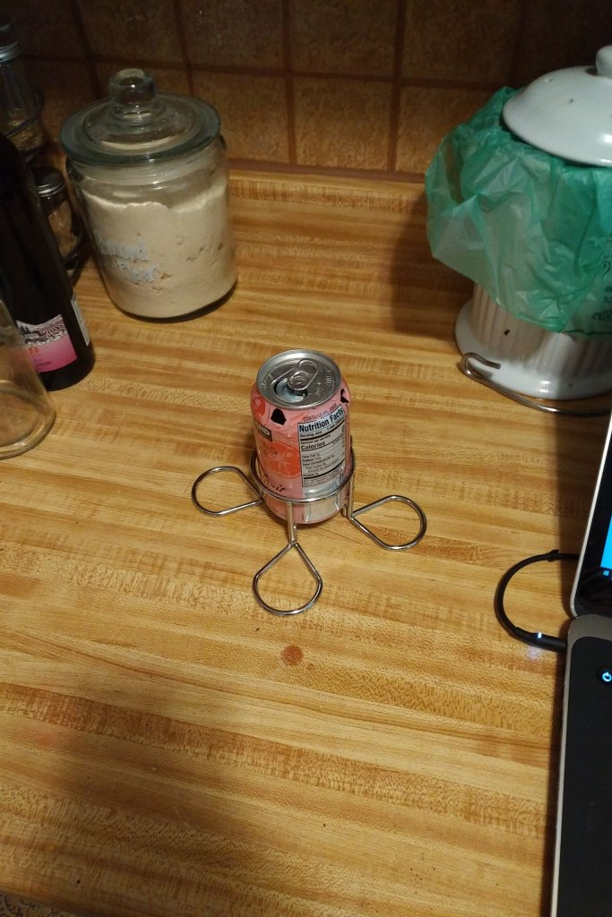 Aluminum can in a stand.