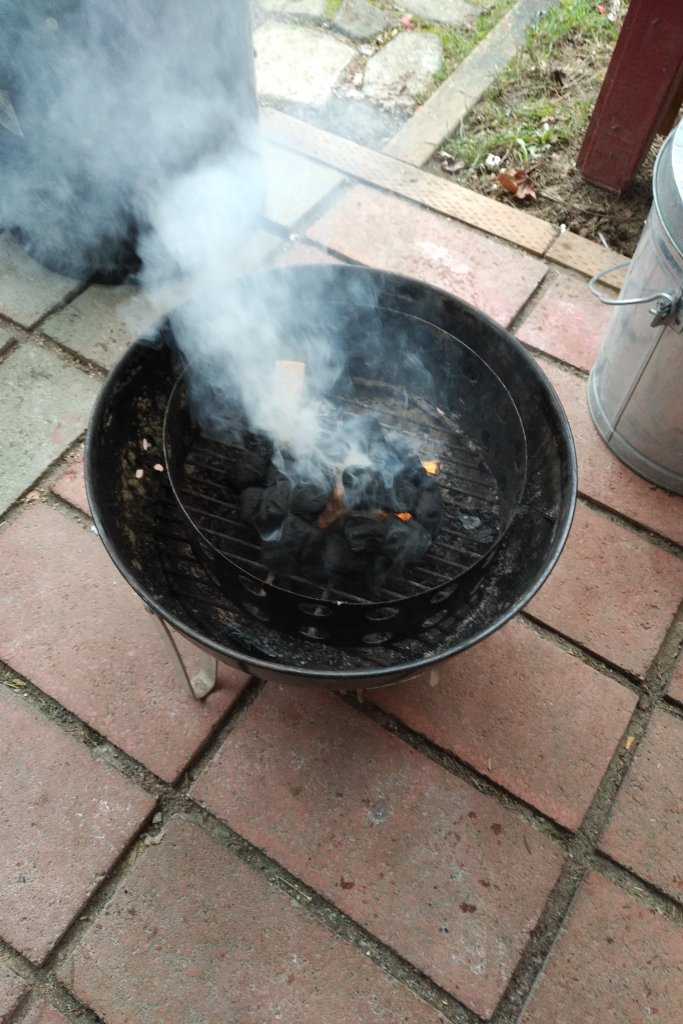 A fire being started in a grill