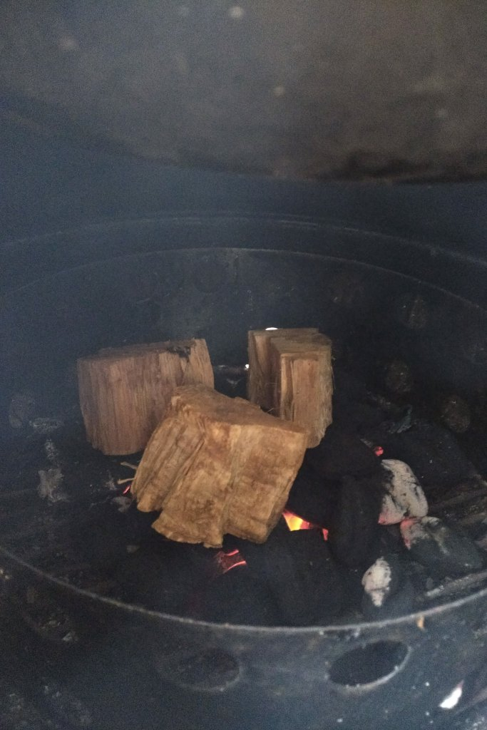 Hickory wood on top of coals.